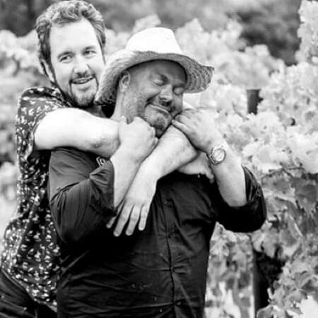 The WC Boys in a loving embrace amongst the vines