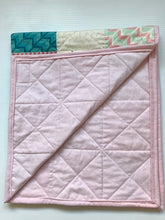 Bassinet sized quilt. This has been finished using traditional methods and measures 76cmx70cm