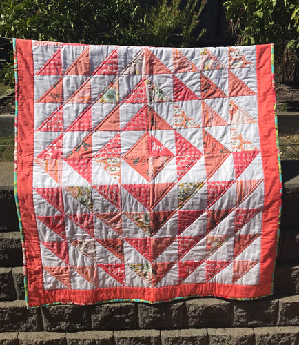 Coral quilt using Art Gallery and Amy Butler fabrics.