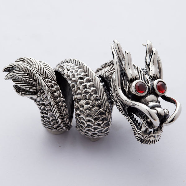huge & heavy sterling silver Chinese dragon ring with red eyes.