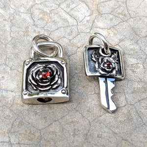 garnet rose lock at key pendant