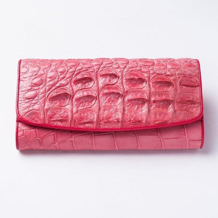 pink trifold crocodile wallet