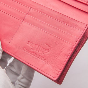 Portefeuille long en peau de crocodile rose Hornback