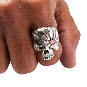 skull silver ring on finger