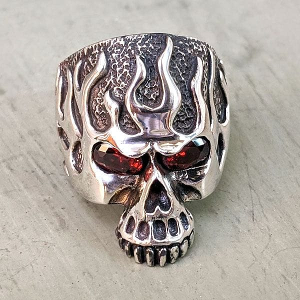 sterling silver red garnet eye flame skull ring