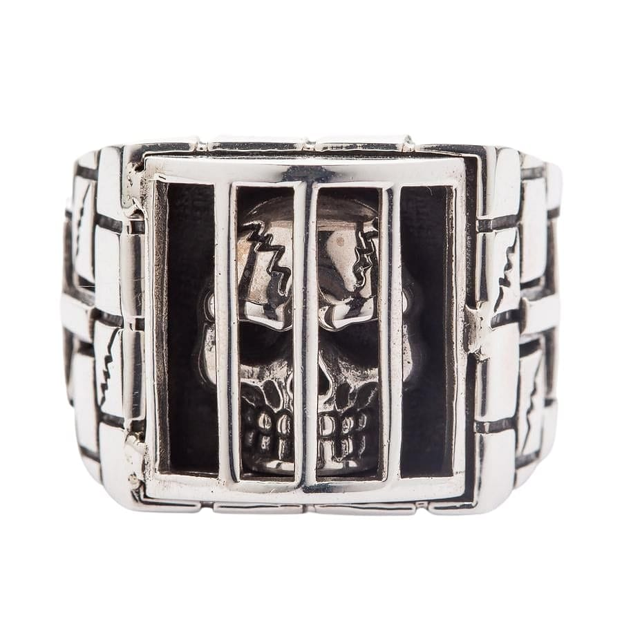 skull in jail biker ring