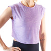 Front view of a lady born primitive violet purple high cut crop top with her right hand on her hip