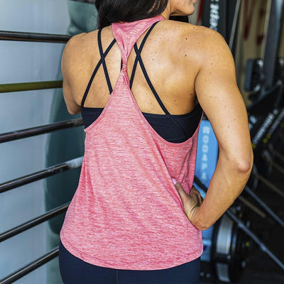 Rear view of lady wearing the coral pink tank top showing a twisted material design on the back of the top