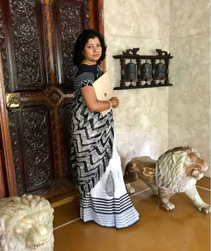 Jaya Devi Cholayil starts her morning in a Jullaaha Batik Blockprint combination saree