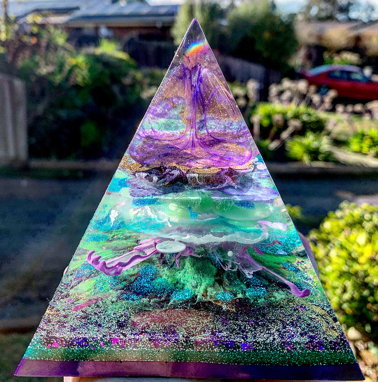 Green, purple and gold resin pyramid