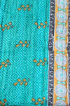 Turquoise and Black Baby Quilt Turquoise Side - Anokha Collection