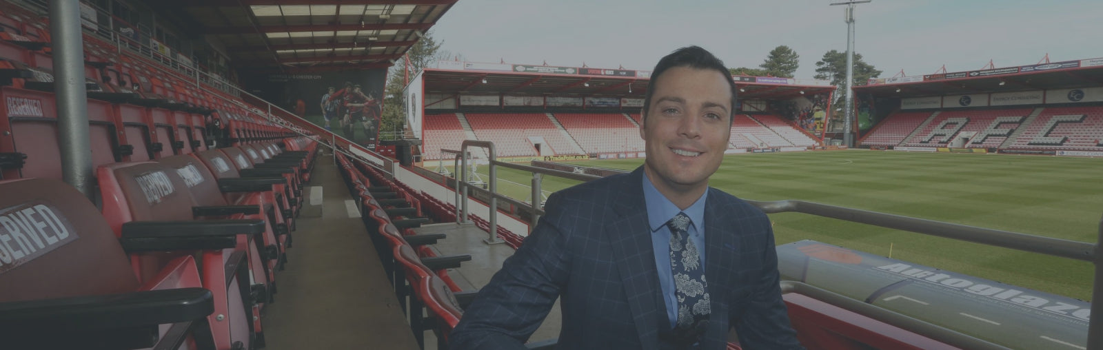 Rob Mitchell, commercial director of AFC bournemouth at Vitality Stadium with testimonial for footballkitsdirect.com