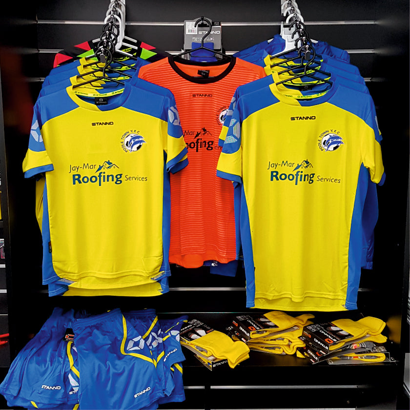 Club shop image of Poole Town Youth football kit with yellow Stanno shirts on hangers within the Footballkitsdirect.com showroom. Image links to club shops page.