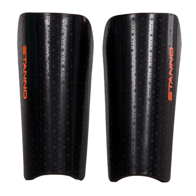 Stanno Pro Shade Shin Guards in black with Orange Stanno Text logo vertically down the outside edge. Crosshatch pattern across the shin pad outer shell.