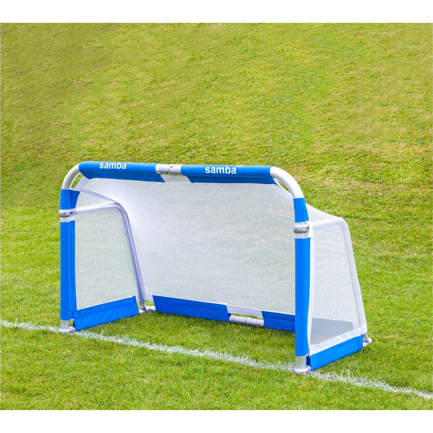 Samba 5' x 3' Aluminium Folding Goal on grass. Blue net fastening around the goal posts, white net
