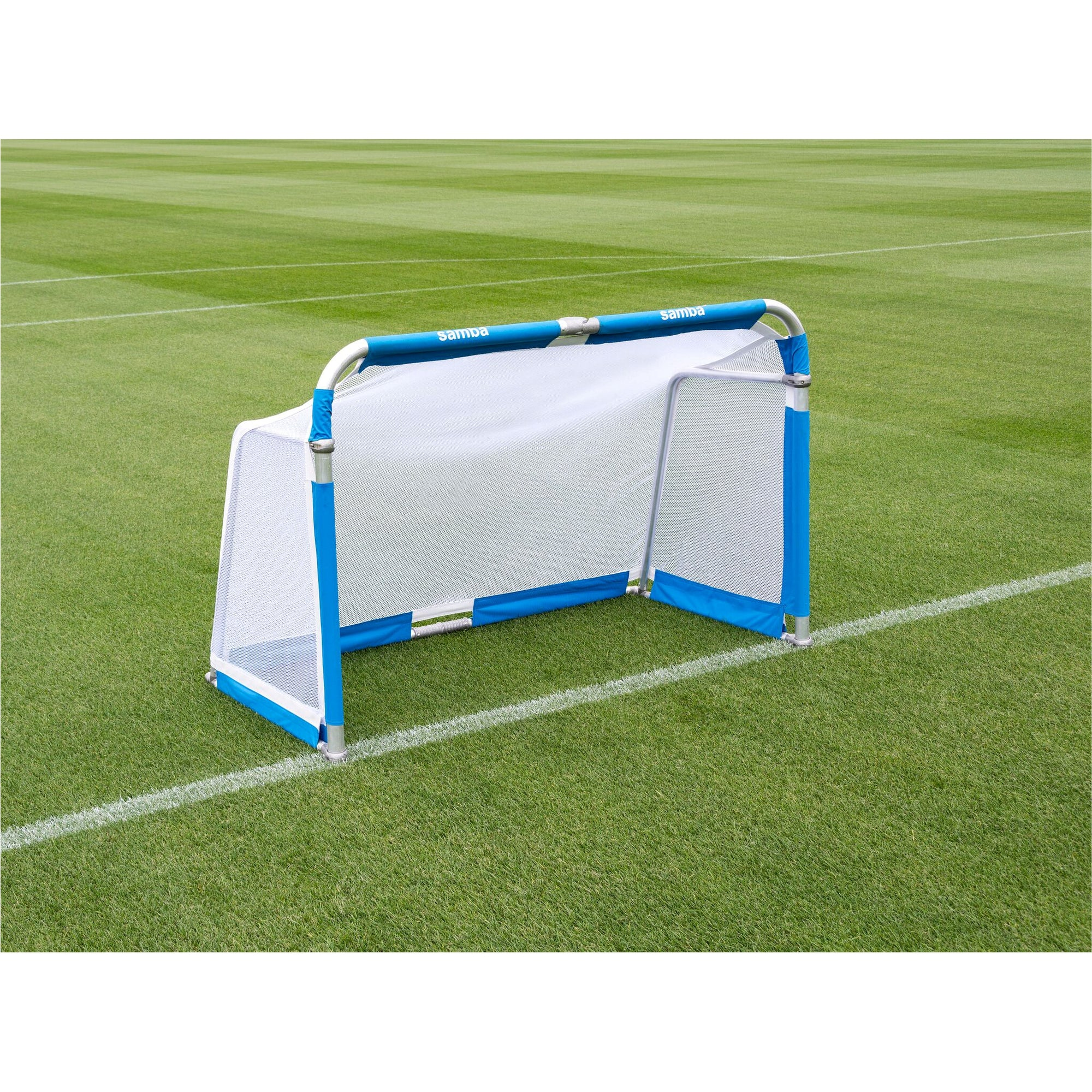 Samba 6' x 4' Aluminium Folding Goal on grass. Blue net fastening around the goal posts, white net