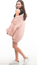 Hand made open knit cardigan in soft pink