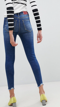 High rise skinny jean with distressed hem