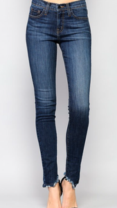 Mid rise skinny ankle jeans with distressed hem