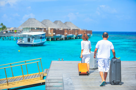 Woman and Man walking on Dock with suitcases