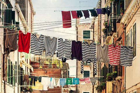 laundry hanging on clotheslines between buildings