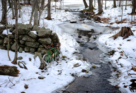 bike near brook in snow