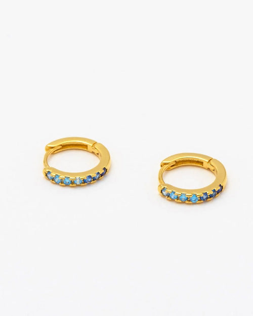 Estella Bartlett blue ombre cz mini hoop earrings are available to buy online from Damsel in Chiswck