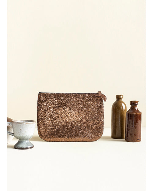 Des Petits Hauts glitter pochette is available from Damsel in Chiswick