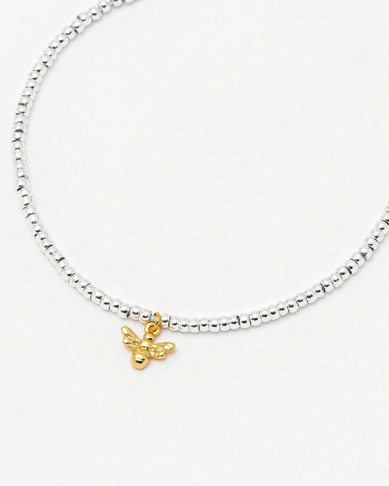 Estella Bartlett silver bracelet with gold bee available from damsel in Chiswick