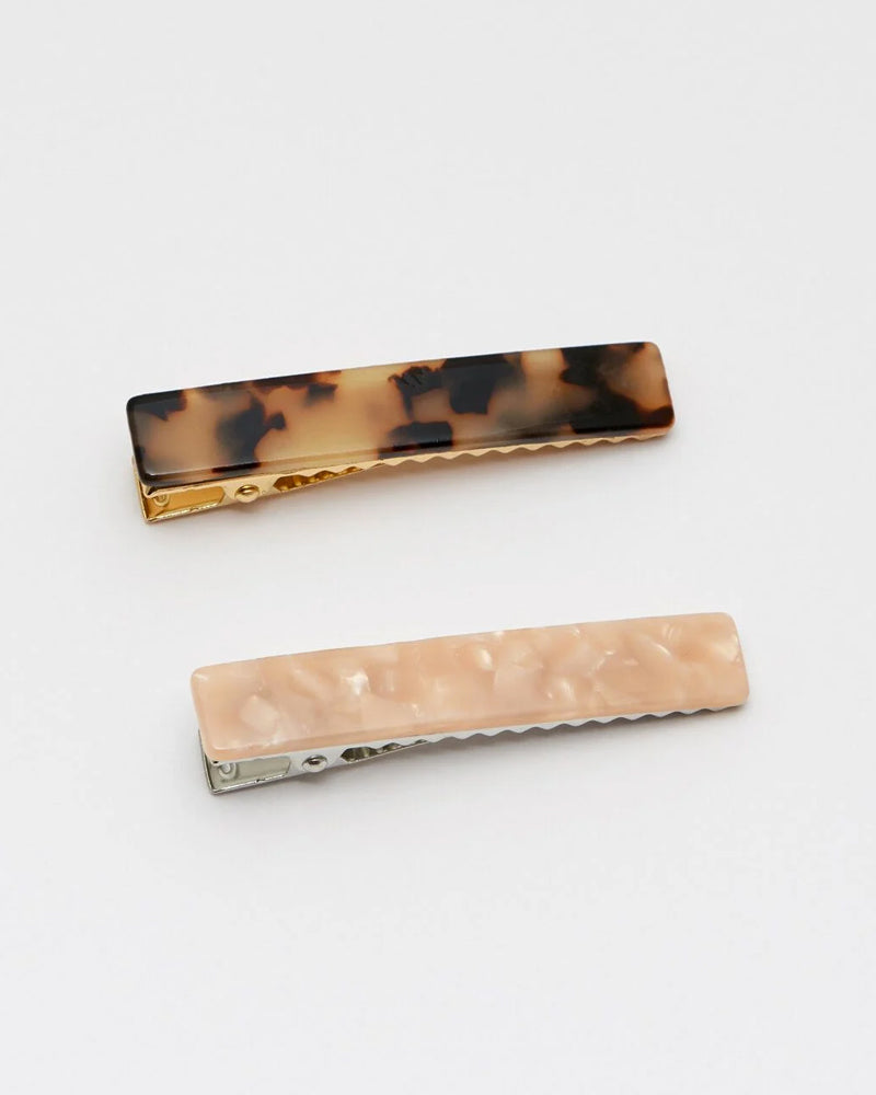 Estella Bartlett hairclips in blush and tortoiseshell are available to buy online from Damsel in Chiswick