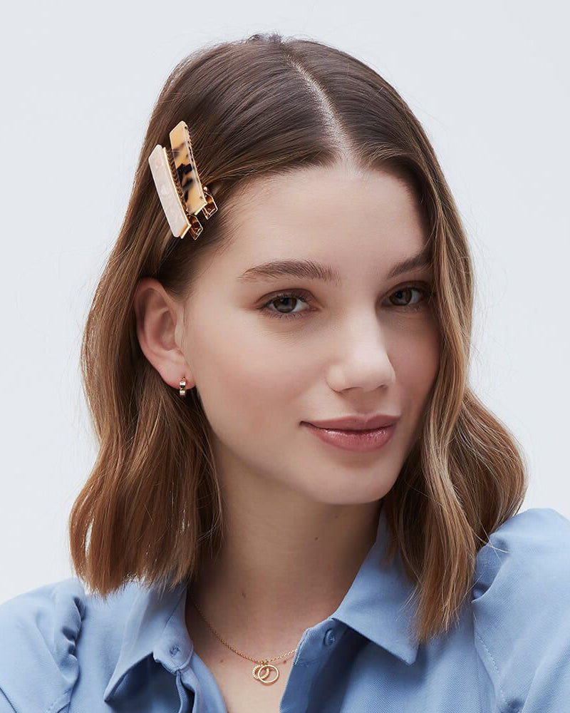 Estella Bartlett hairclips in tortoiseshell and blush are available to buy online from Damsel in Chiswick