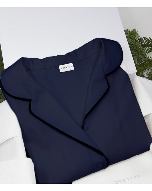 Breathe and Protect organic cotton pyjamas in navy are available to buy online from Damsel in Chiswick