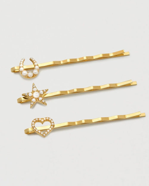 Estella Bartlett pearl embellished hairclips are available to buy online from Damsel in Chiswick