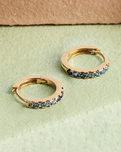 Estella Bartlett mini hoop earrings with blue ombre crystals are available to buy online from Damsel in Chiswick