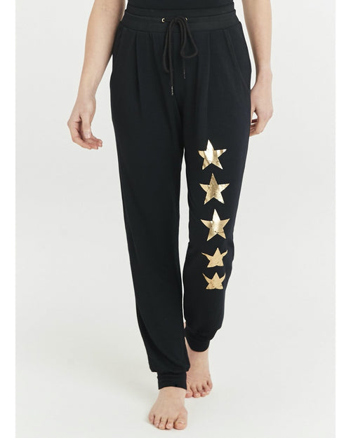 A Postcard from Brighton five star gold joggers are available to buy online from Damsel in Chiswick