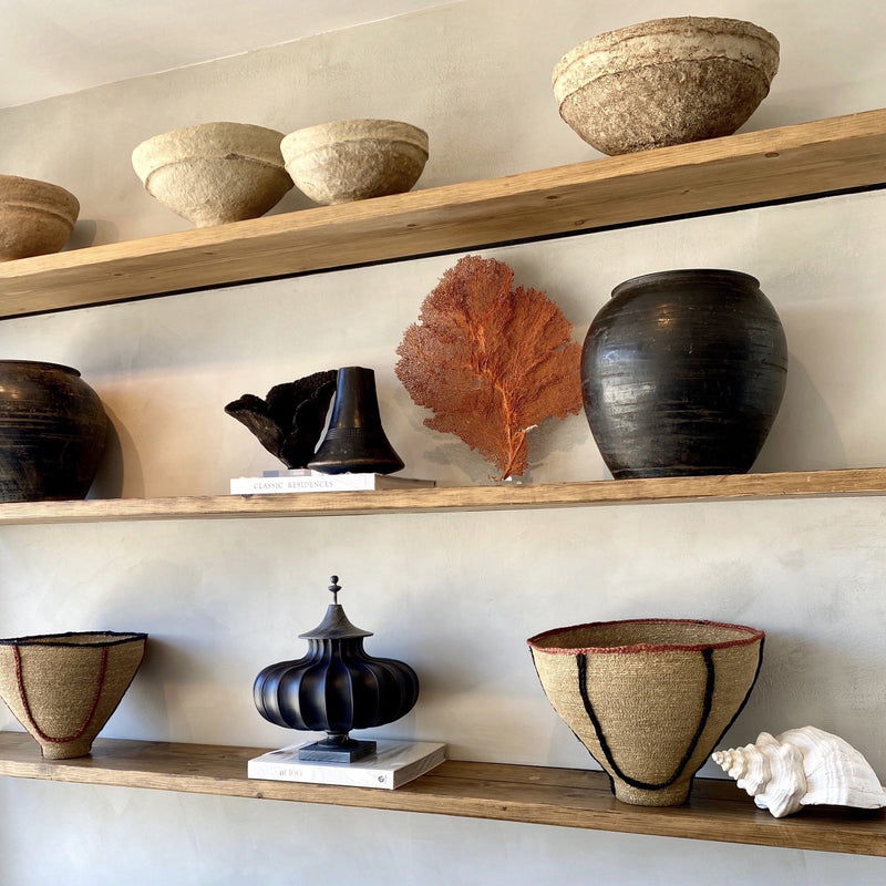 Kier Design Palisades home decor and lifestyle store featuring vintage clay pots.