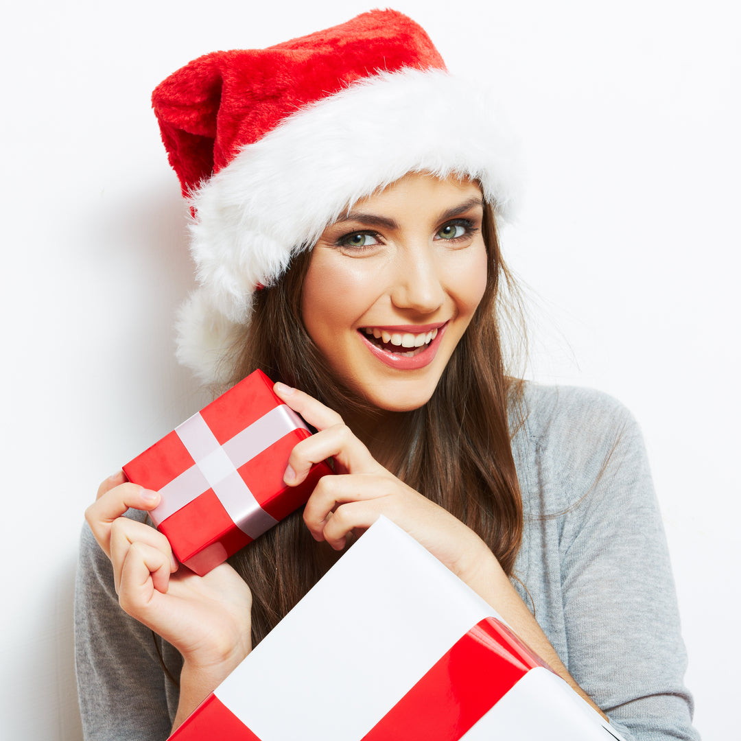 top Christmas gifts for women - happy girl holding gifts