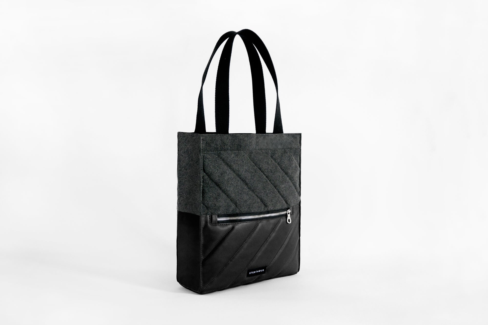 STERTHOUS - hand-quilted vegan leather tote bag with laptop pocket | sustainable product design | made in USA
