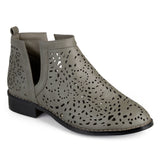 Brinley Co. Womens Stacked Heel Laser Cut Faux Leather Booties