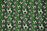 Soccer Balls on Green Background