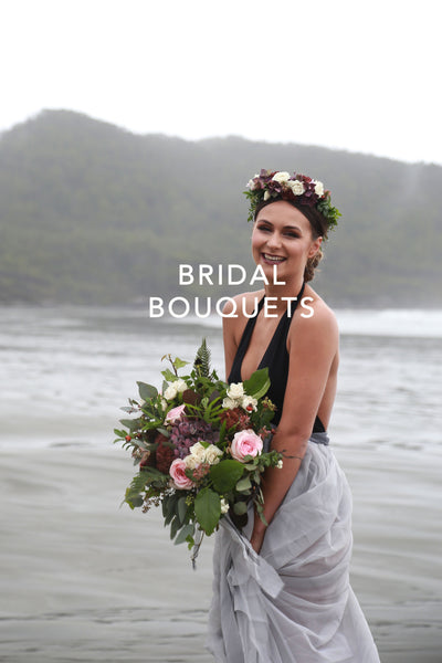 Tofino Wedding Flowers - Wild Bloom Floral Design - foggy beach scene with bride in floral hair piece with light pink deep purple palette bridal bouquet