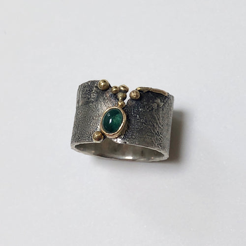 Oval Green Tourmaline in 18k gold bezel, reticulated silver ring oxidized