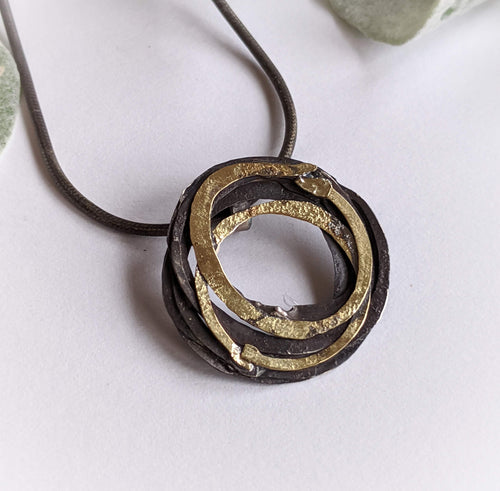 Oxidized Silver and 18K Gold Wrap Pendant