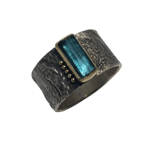 blue tourmaline crystal in gold on erosion band