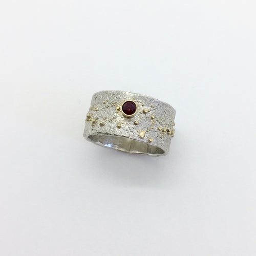 Reticulated Silver Ring with 18k gold powder fused and 3mm round Garnet set in 18k gold bezel