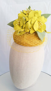 Yellow and green sinamay button headpiece with leather flowers