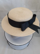 Ladies ivory and french navy blue straw boater hat
