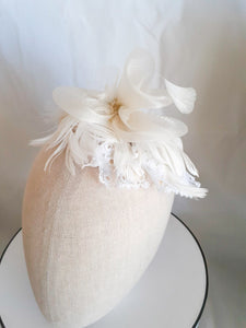 Ivory crinoline feathers and lace headpiece
