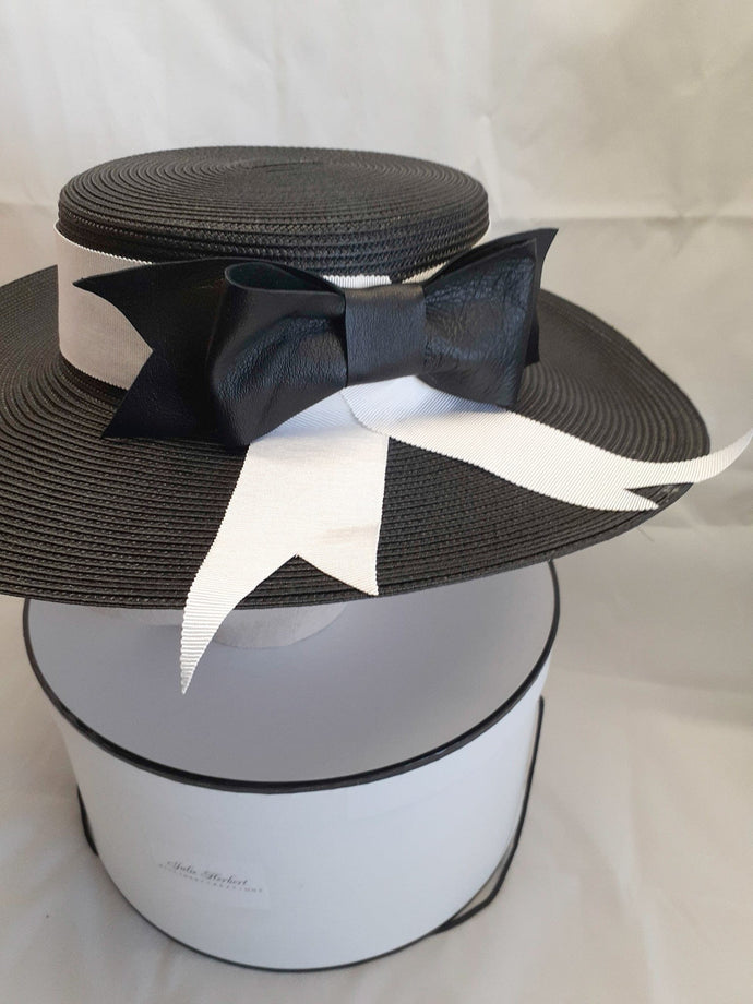 Ladies black and white leather bow brim hat