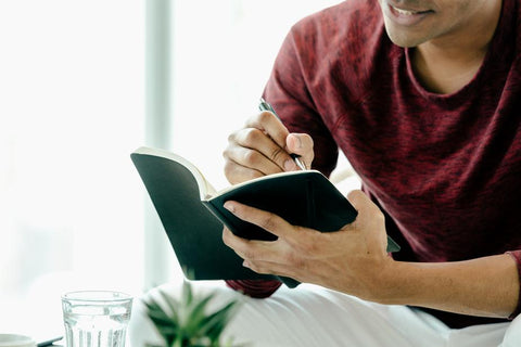 Man writing in journal
